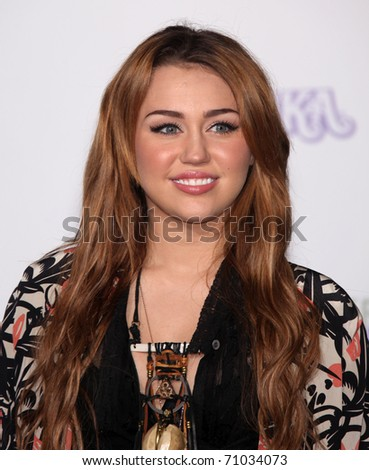 """LOS ANGELES - FEB 09:  MILEY CYRUS arrives to the """"Justin Bieber: Never Say Never"""" Los Angeles Premiere  on February 08,2011 in Los Angeles, CA"""