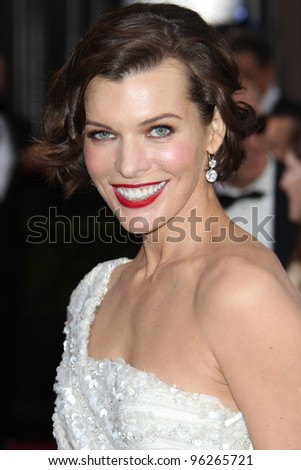 LOS ANGELES - FEB 26:  Milla Jovovich arrives at the 84th Academy Awards at the Hollywood & Highland Center on February 26, 2012 in Los Angeles, CA. - stock photo