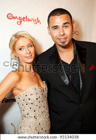 "LOS ANGELES - FEB. 12: Paris Hilton & Afrojack attends the ""Fame At The Mansion"" 2012 Grammy Aterparty hosted by Sean ""Diddy"" Combs held at the Playboy Mansion. Los Angeles, Feb 12, 2012"
