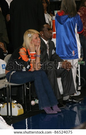 LOS ANGELES - FEB 13: Paris Hilton, P Diddy aka Sean Combs at the NBA All Star Celebrity Game on February 13, 2004 at the Los Angeles Convention Center in Los Angeles, California - stock photo