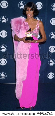 LOS ANGELES - FEB 23:  Whitney Houston arrives at the 1998 Grammy Awards at Staples Center on February 23, 1998 in Los Angeles, CA - stock photo