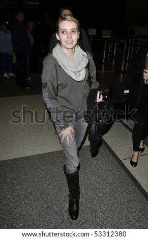 LOS ANGELES - FEBRUARY 9: Actress Emma Roberts niece to actress Julia Roberts is seen all smiles a she makes her way thru LAX (lLos Angeles Airport). February 9, 2010 in los angeles, california