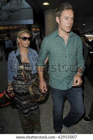 LOS ANGELES-FEBRUARY 14: Actress SInger Jessica Simpson is seen with boyfriend Eric Johnson at LAX. February 14th, 2010 in Los Angeles, California