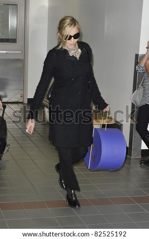 LOS ANGELES-FEBRUARY 26: Singer Madonna is seen at LAX. February 26, 2010 in Los Angeles, California
