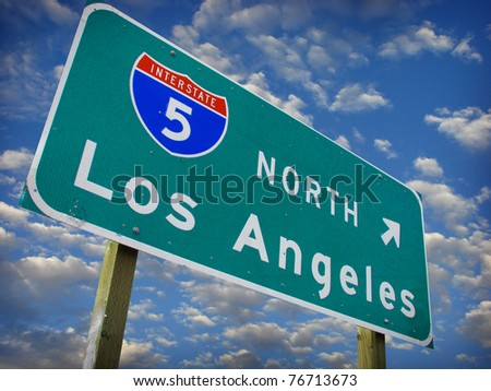 los Angeles freeway north sign with cloudy sky.