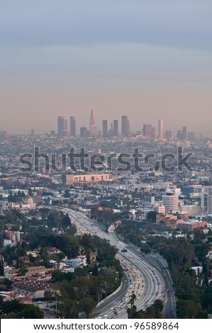 Los Angeles. Image of Los Angeles at twilight with busy freeway in the foreground.