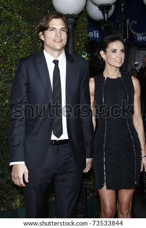 LOS ANGELES - JAN 11:  Ashton Kutcher and Demi Moore arrives at the premiere of 'No Strings Attached' at the Regency Village Theater in Los Angeles, CA on January 11, 2011.