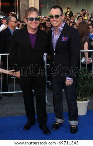 "LOS ANGELES - JAN 23:  Elton John & David Furnish arrive at the ""Gnomeo & Juliet"" World Premiere on January 23, 2011 in Los Angeles, CA - stock photo"