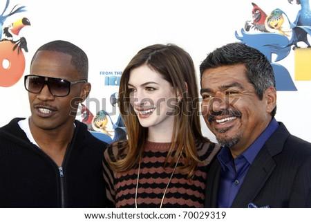 "LOS ANGELES - JAN 28:  Jamie Foxx, Anne Hathaway, George Lopez arrive at the Sneak 'Beak' Screening ""Rio"" at 20th Century Fox - Zanuck Theater on January 28, 2011 in Los Angeles, CA"