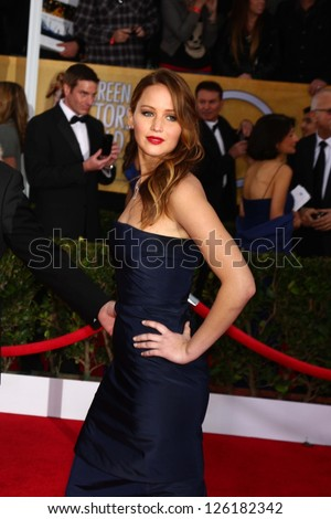 LOS ANGELES - JAN 27:  Jennifer Lawrence arrives at the 2013 Screen Actor's Guild Awards at the Shrine Auditorium on January 27, 2013 in Los Angeles, CA - stock photo