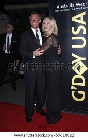 LOS ANGELES - JAN 22:  John Easterling, Olivia Newton John arrives at the 2011 G'Day USA Australia Week LA Black Tie Gala at Hollywood Palladium on January 22, 2011 in Los Angeles, CA