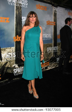 "LOS ANGELES - JAN 18:  Lucy Lawless. arrives at  the ""Spartacus: Vengeance"" Screening of the STARZ Series Season 3 Premiere at ArcLight Theaters on January 18, 2012 in Los Angeles, CA"