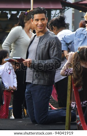 "LOS ANGELES - JAN 31: Mario Lopez films the television show ""Extra"" at The Grove in Los Angeles, CA on January 31,  2012."