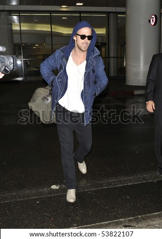 LOS ANGELES - JANUARY 26 : Actor Ryan Gossling is seen all smiles in a hooded jacket as he arrives at LAX airport. January 26, 2010 in Los Angeles, California