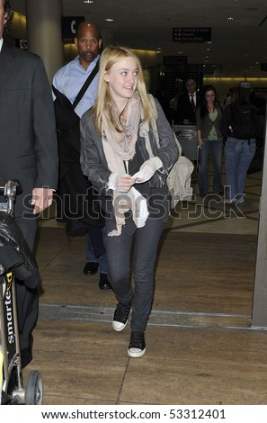 LOS ANGELES - JANUARY 25: Actress Dakota Fanning is seen all msiles as she arrives at LAX airport. January 25, 2010 in los angeles, california