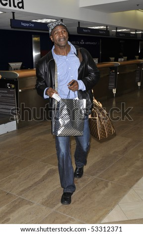 LOS ANGELES - JANUARY 25: Former world heavyweight boxing champion Evander holyfield is seen at LAx airport . January 25, 2010 in los angeles , california