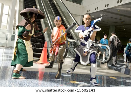 LOS ANGELES - JULY 5: Anime fans portray characters from the series 'Avatar: The Last Airbender' at the Anime Expo 2008 at the Los Angeles Convention Center July 5, 2008 in Los Angeles, CA. - stock photo