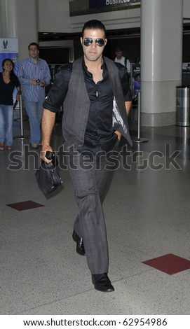 LOS ANGELES-JULY 23: Latino actor/singer JenCarlos Canela is seen at LAX . July 23rd, 2010 in Los Angeles, California