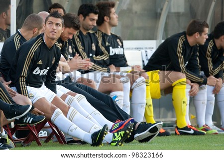 LOS ANGELES - JULY 16: Real Madrid C.F. F Cristiano Ronaldo #7 on the bench during the first half of the World Football Challenge game on July 16 2011 at Los Angeles Memorial Coliseum in Los Angeles. - stock photo