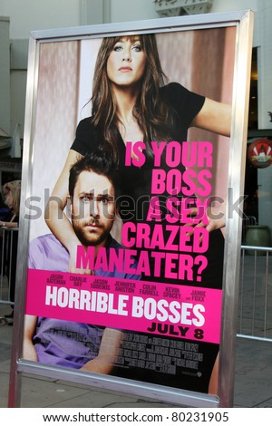 "LOS ANGELES - JUN 30:  Horrible Bosses Movie Poster with Jennifer Aniston, Charlie Day arriving at the ""Horrible Bosses"" Premiere at Graumans Chinese Theater on June 30, 2011 in Los Angeles, CA"