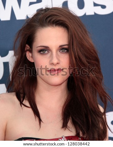 LOS ANGELES - JUN 05:  KRISTEN STEWART arriving to MTV Movie Awards 2011  on June 05, 2011 in Hollywood, CA - stock photo