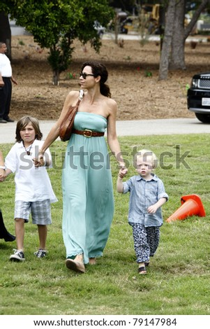 LOS ANGELES - JUN 12:  Minnie Driver, son Henry arriving at the 22nd Annual 'Time for Heroes' Celebrity Picnic at Wadsworth Theater on June 12, 2011 in Westwood, CA