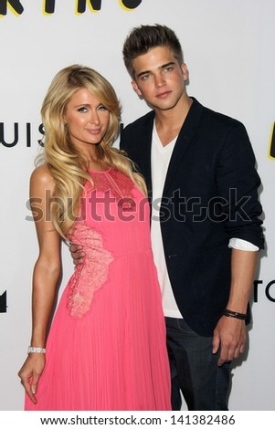 """LOS ANGELES - JUN 4:  Paris Hilton, River Viiperi arrivesa at the """"The Bling Ring"""" Los Angeles Premiere at the DGA Theater on June 4, 2013 in Los Angeles, CA"""