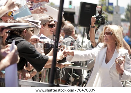 LOS ANGELES - JUNE 2: American actress Bo Derek meets her fans at the Shania Twain Hollywood Walk of Fame Star Ceremony at Hollywood Blvd on June 2, 2011 in Los Angeles, CA. - stock photo