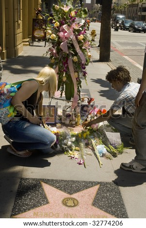 LOS ANGELES - JUNE 26: Fans arrange flowers and candles on Farrah Fawcett's star on the Hollywood Walk of Fame on June 26, 2009 in Los Angeles. Fawcett, 62, died June 25 after battling cancer.