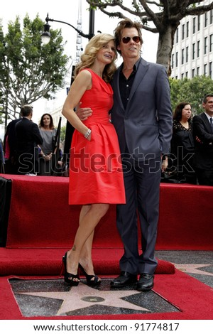 LOS ANGELES - JUNE 8: Kyra Sedgwick is posing with husband Kevin Bacon as she receives the 2,384th Star on the Hollywood Walk of Fame, Los Angeles, California, USA, on June  8, 2009.