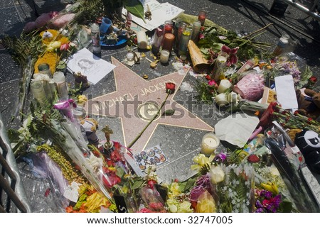 LOS ANGELES - JUNE 26: Michael Jackson's star on the Hollywood Walk of Fame in Los Angeles, CA, as fans gather and leave flowers and momentos to remember the artist and say goodbye following his death on June 25, 2009.
