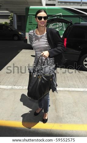 LOS ANGELES-JUNE 15: Supermodel Miaranda Kerr is seen at LAX. June 15, 2010 in Los Angeles, California