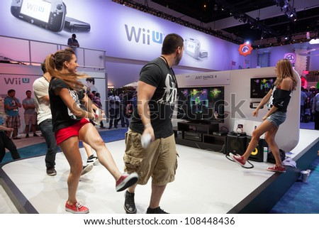 LOS ANGELES - JUNE 8: Ubisoft showing Just Dance 4 on the Nintendo WiiU console for the firs time during E3 2012, world video games Expo June 8, 2012 in Los Angeles, CA - stock photo