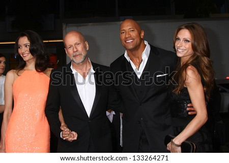 "LOS ANGELES - MAR 28:  Emma Heming, Bruce Willis, Dwayne Johnson, Lauren Hashian arrives at the ""G.I. Joe: Retaliation""  LA Premiere at the Chinese Theater on March 28, 2013 in Los Angeles, CA"