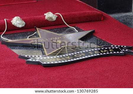 LOS ANGELES - MAR 7: James Franco star covered up at a ceremony as James Franco is honored with a star on the Hollywood Walk of Fame on March 7, 2013 in Los Angeles, California - stock photo