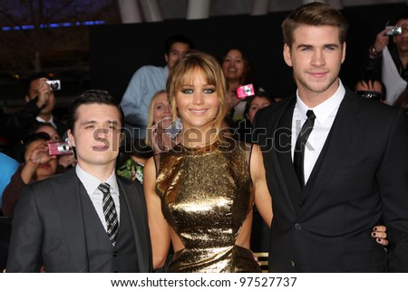 """LOS ANGELES - MAR 12:  Josh Hutcherson; Jennifer Lawrence; Liam Hemsworth arrives at the """"Hunger Games"""" Premiere at the Nokia Theater at LA Live on March 12, 2012 in Los Angeles, CA"""