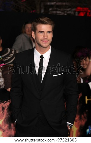 """LOS ANGELES - MAR 12:  Liam Hemsworth arrives at the """"Hunger Games"""" Premiere at the Nokia Theater at LA Live on March 12, 2012 in Los Angeles, CA"""