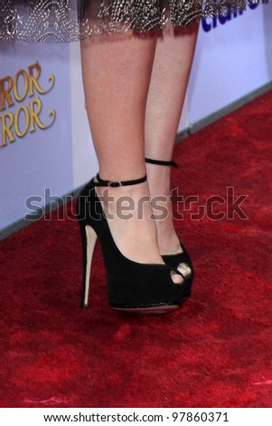 """LOS ANGELES - MAR 17:  Lily Collins at the """"Mirror, Mirror"""" Premiere at the Graumans Chinese Theater on March 17, 2012 in Los Angeles, CA - stock photo"""