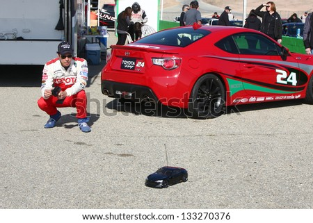 LOS ANGELES - MAR 23:  Michael Trucco playing with a remote control car at the Toyota Pro/Celebrity Race training at the Willow Springs International Speedway on March 23, 2013 in Rosamond, CA