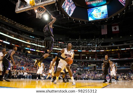 LOS ANGELES - MARCH 12: Arizona Wildcats F Solomon Hill #44 (R) & Washington Huskies G Terrence Ross #31 (L) during the NCAA Pac-10 Tournament basketball championship game on March 12 2011 in Los Angeles, CA. - stock photo