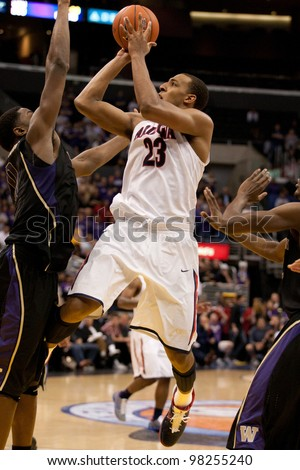 LOS ANGELES - MARCH 12: Arizona Wildcats forward Derrick Williams #23 gets a shot off during the NCAA Pac-10 Tournament basketball championship game on March 12 2011 at Staples Center in Los Angeles, CA.