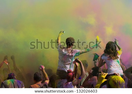 LOS ANGELES - MARCH 16 : Dancing and celebrating during the color throw. Holi Festival of Colors on March 16, 2013 in Los Angeles, CA