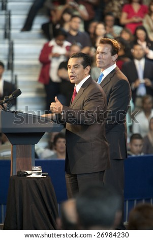 LOS ANGELES - MARCH 19: L.A. mayor Antonio Villaraigosa and California governor Arnold Schwarzenegger introduce President Barack Obama on March 19th, 2009 in Los Angeles.