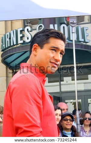 LOS ANGELES - MARCH 15: Tabloid television host and actor Mario Lopez films the tv show EXTRA at The Grove shopping mall on March 15, 2011 in Los Angeles, CA.