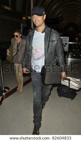 LOS ANGELES-MAY 25: Actor Josh Duhamel with wife singer Fergie at LAX airport. May 25 in Los Angeles, California 2010