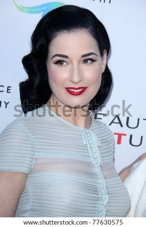LOS ANGELES - MAY 19:  Dita Von Teese arriving at the Opening Night of the Beauty Culture Exhibit at The Annenberg Space For Photography on May 19, 2011 in Century City, CA