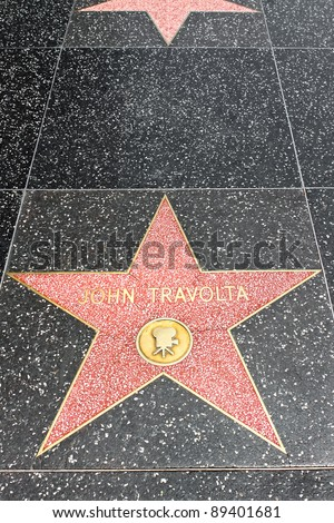 LOS ANGELES - MAY 18: John Travolta's star on the Hollywood Walk of Fame at Hollywood Blvd on May 18, 2009 in Hollywood, Los Angeles, CA. It is one of 2400 celebrity stars.
