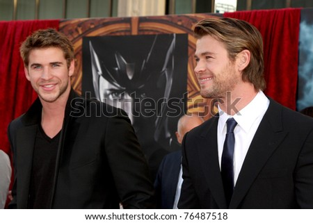 """LOS ANGELES - MAY 2:  Liam Hemsworth, Chris Hemsworth arriving at the """"Thor"""" World Premiere at El Capitan theater on May 2, 2011 in Los Angeles, CA"""