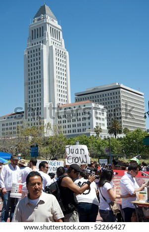 LOS ANGELES - MAY 1: Near the City Hall, people march in Downtown on support to Arizona immigrants and demanding an immigration reform on May 1, 2010 in Los Angeles.