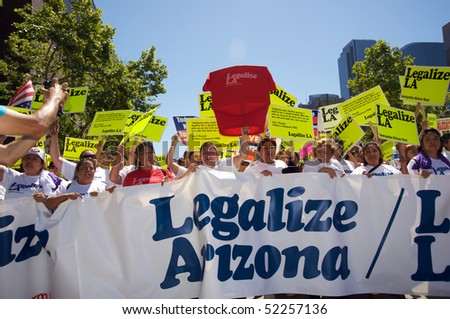 LOS ANGELES - MAY 1: On International Workers' Day, people march in Downtown on support to Arizona immigrants, gay rights and demand an immigration reform on May 1, 2010 in Los Angeles.